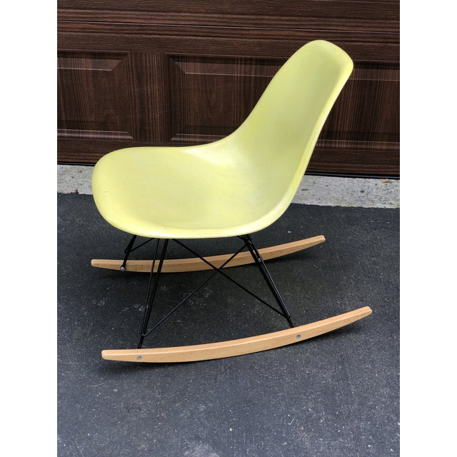 Cheery citron yellow rocker, believed to be Eames for Herman Miller. Eiffel Tower base, possibly a marriage. Shocks appear...