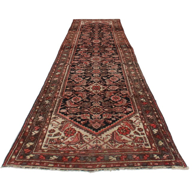 For sale is this vintage Persian Hamedan runner. Made of hand-knotted wool. Features an ornate geometric design.