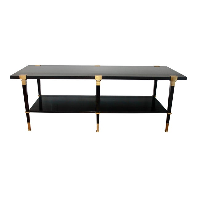 Stunning Andre Arbus 'Avenue' cocktail table. Ebonized walnut with substantial satin brass hardware. Produced by Baker...
