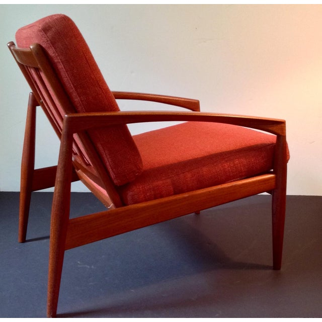This is a rare solid teak lounge chair in very good untouched original condition. It is a very comfortable chair with a...