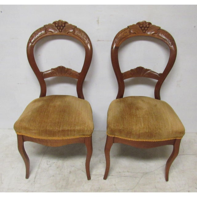 Pair of Victorian balloon back chairs, cherry wood with carved and crested  back with grape - Victorian Balloon Back Chairs - A Pair Chairish