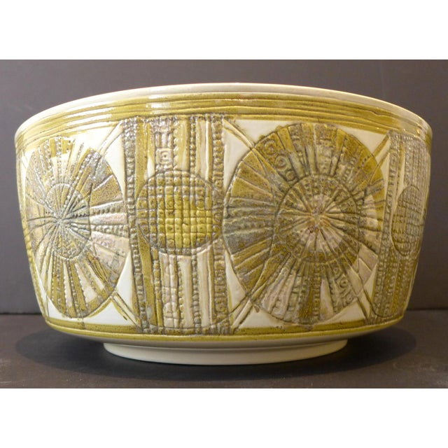 Large footed faience bowl with raised, incised, and glazed decorative frieze, by Danish ceramist Kari Christensen Kroese....