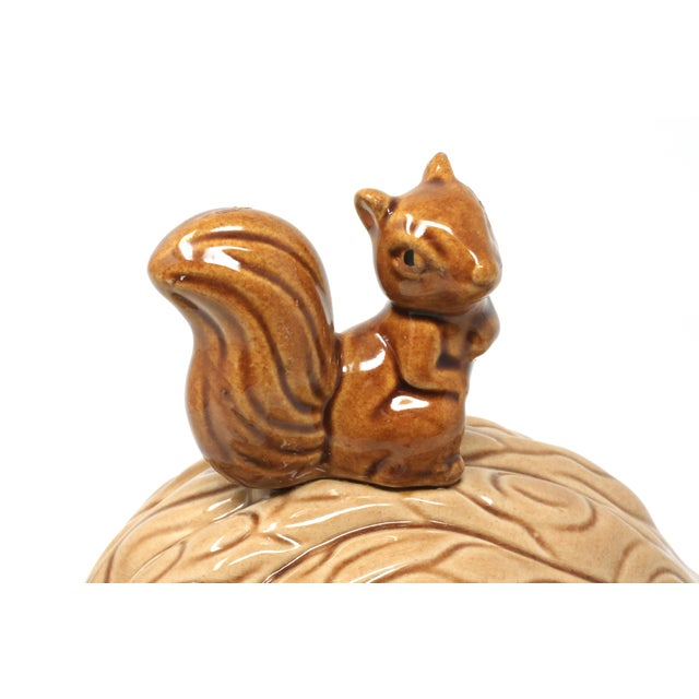 A vintage, ceramic lidded bowl or box, the form of a large walnut with figural squirrel handle. Excellent vintage...