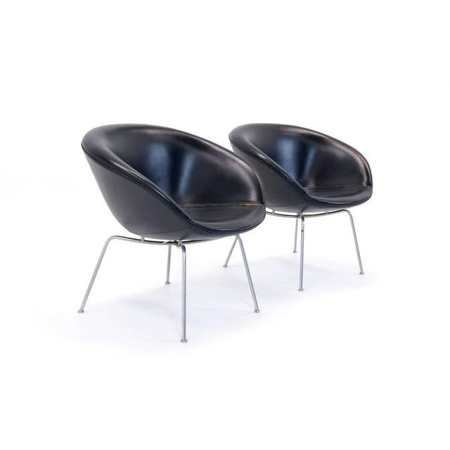 Pair of Pot chairs by Arne Jocobsen retaining their original Naugahyde upholstery.
