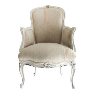 Antique Louis XV Style Painted French Bergère Chair With Linen Upholstery For Sale
