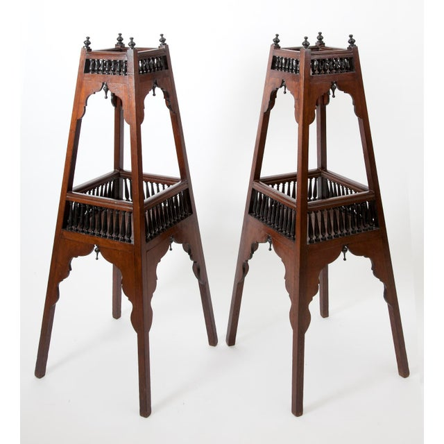 A pair of antique English Regency etageres, of pyramidal form, composed of polished solid mahogany and painted, ebonized...