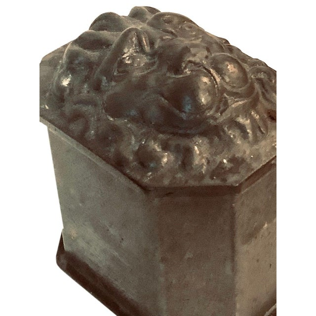 The lead box with Lion head on top and it is an octagon shape. It is early 1900's from France. A wonderful thing that came...