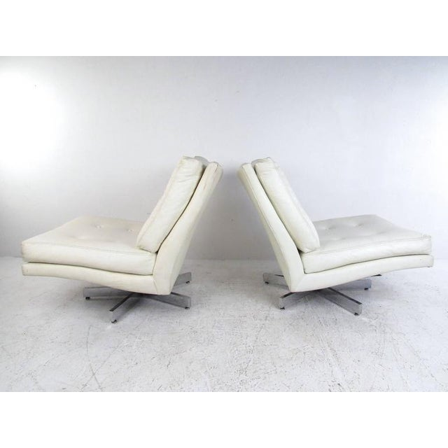 This stylish pair of swivel chairs for Thayer Coggin feature the stylish Mid-Century design of Milo Baughman. Tufted...