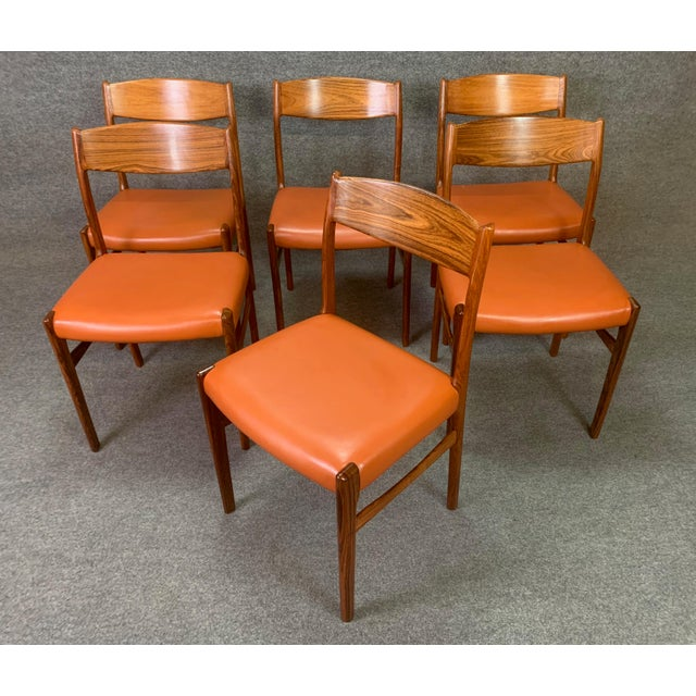 Here is a set of six 1960's Scandinavian Modern dining chairs in Brazilian rosewood and leather attributed to Vestervig...