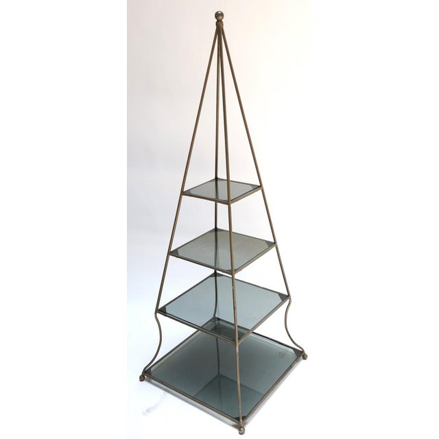 Pair of 1960s metal pyramid etageres with four smoked glass shelves.