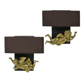 A Pair of Adorable Gilt Brass Cherub Wall Sconces For Sale
