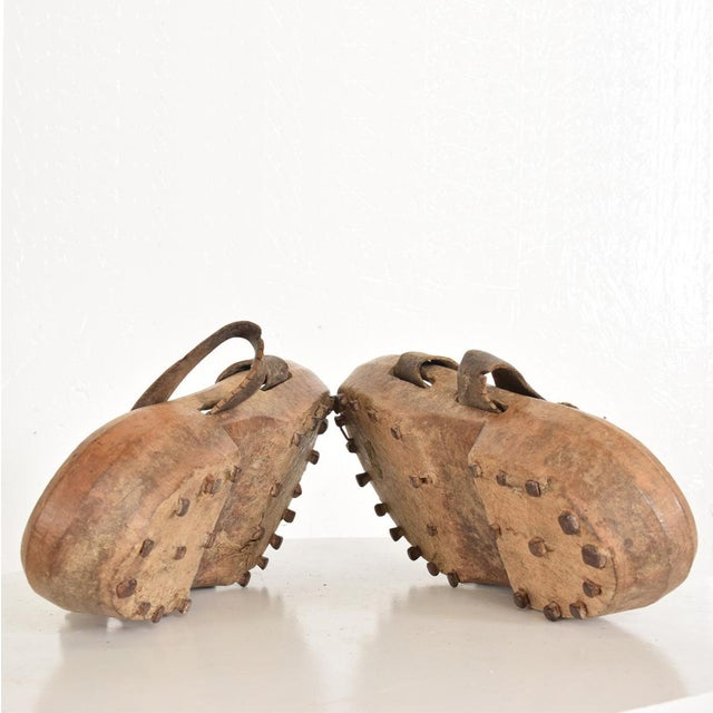 For your consideration a set of antique wood and leather shoes with metal spikes. A beautiful character with the original...
