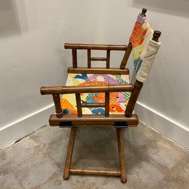 Vintage needlepoint director's chair with faux bamboo arms and legs. Colorful fish in eye popping orange, green, purple...