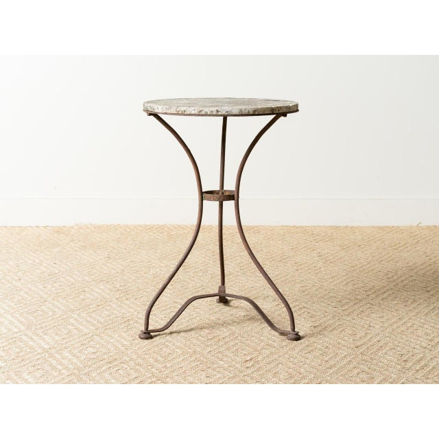 Belle Epoque marble topped cast iron bistro table. Made in France in the 1890s.