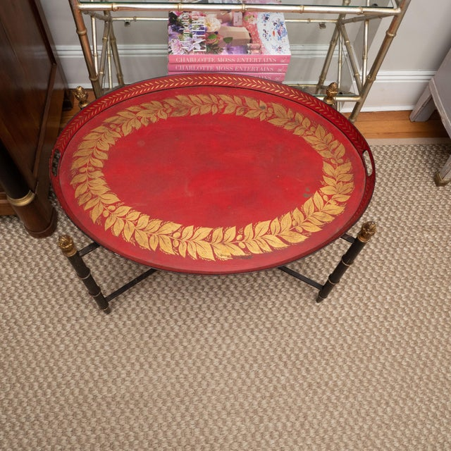 A lovely tole tray with a gallery in a custom stand. The tray, painted in a rich red, features a design painted in gold on...