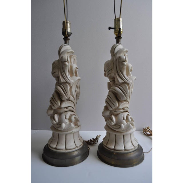 Beautiful pair of sculptural scroll plaster lamps with Baroque styling attributed to Chapman. Features original cream...