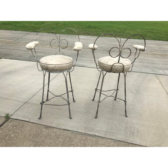 Pair of Antique Twisted Wrought Iron Heart Back Wrought Iron Ice Cream Parlor Bar Stools. Upholstery covered round seats...