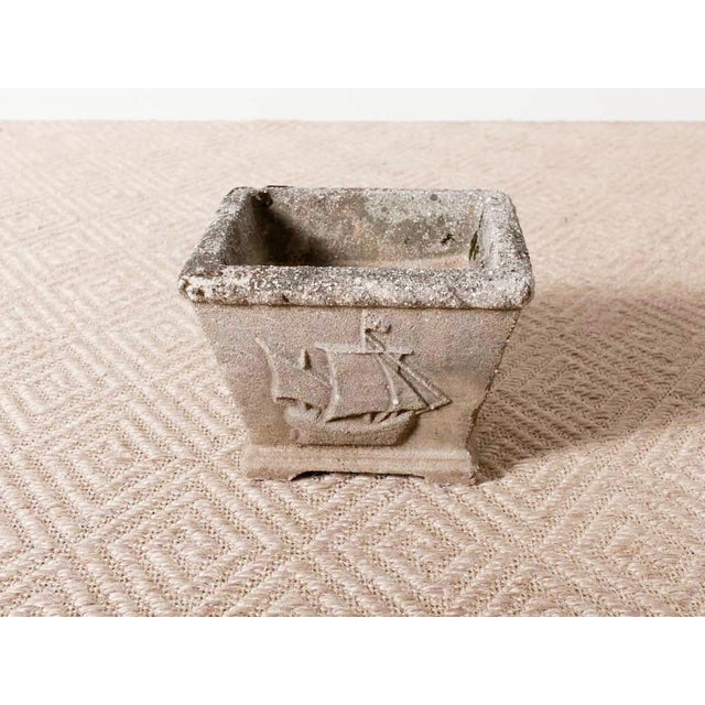Vintage cast stone planter. Lion crest and sailing ship details on the sides. Two available.