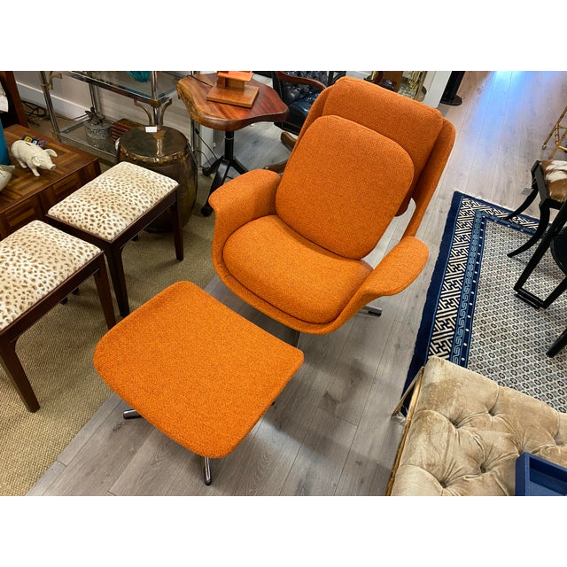 Mid-century womb chair with ottoman with original design from the Standing furniture, made in Finland. newly upholstered