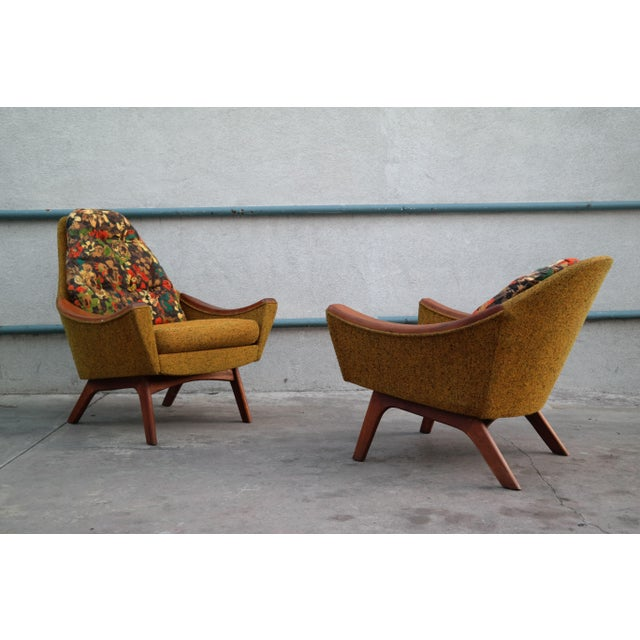 Pair of rare his and hers lounge chairs, designed by Adrian Pearsall for Craft Associates, with dramatic swooping arm...