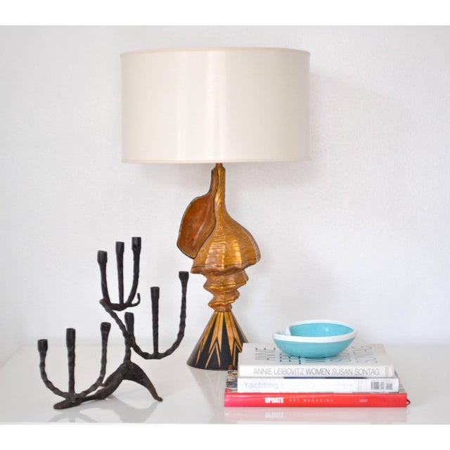 Striking midcentury Brutalist handwrought candlestick, circa 1950s-1960s. This highly decorative and sculptural...