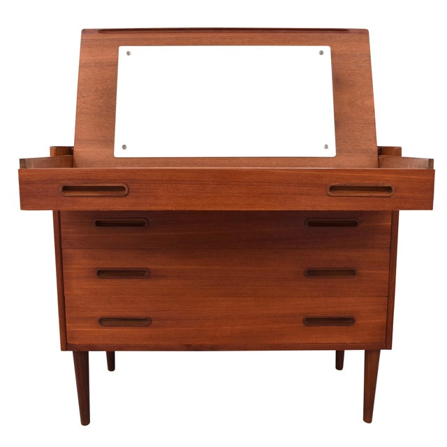 Vintage 1950s Danish modern teak vanity. This beautifully made vanity features a pull-out mirror and make-up drawer that...
