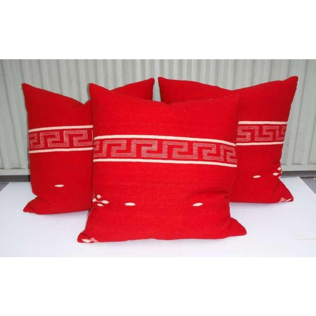 Collection of handwoven Texcoco pillows. Beautifully woven with red dyed wool, these pillows reflect the early influences...