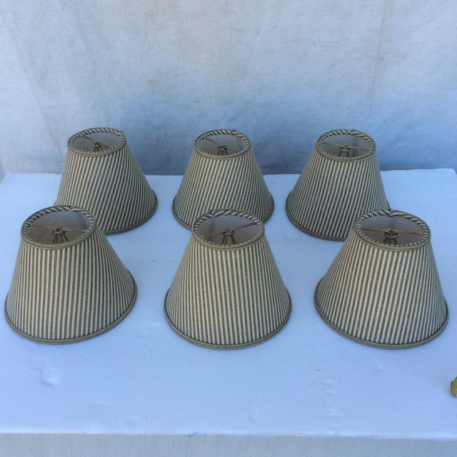 Nice set Of Six custom shades with striped fabric, these are made to attach to a Chandelier Bulb.