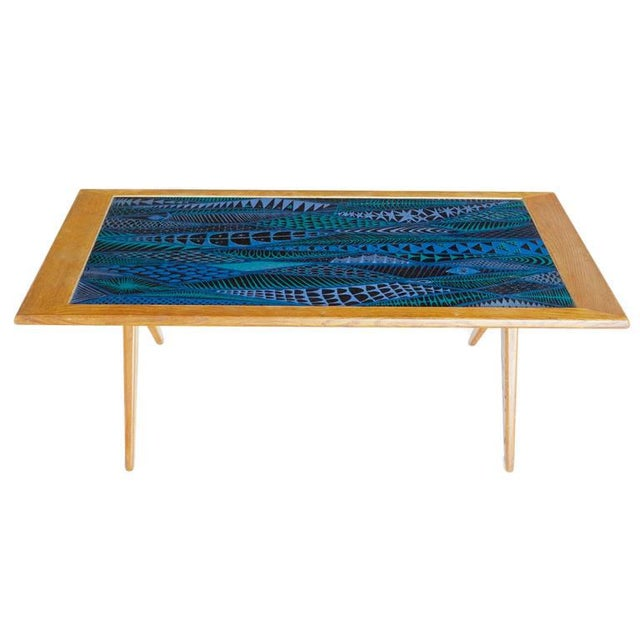 Designed by Stig Lindberg and David Rosen for Nordiska Kompaniet, this artistic coffee table can serve as a masterful...