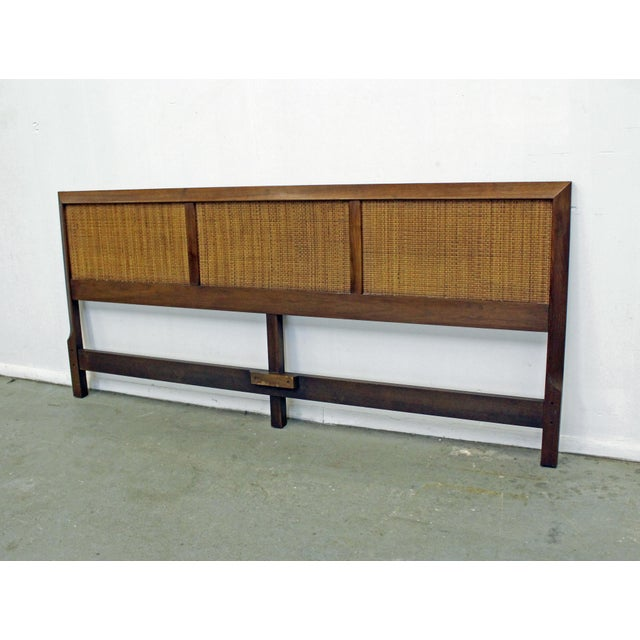 Offered is a vintage mid-century walnut and cane king-size headboard similar to the style of John Stuart. It is in good...