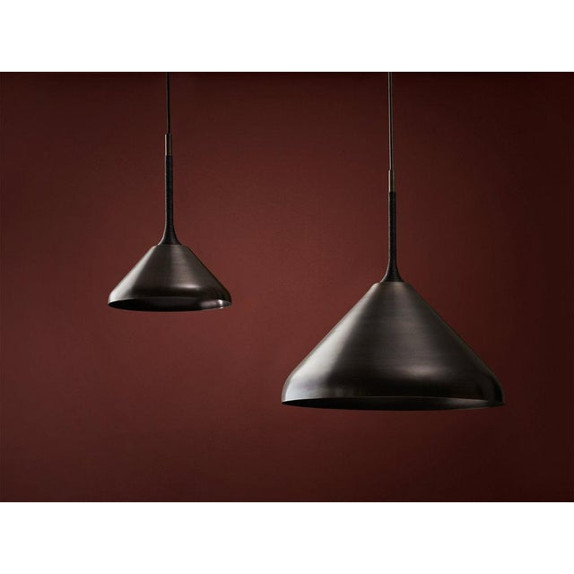 """By Pelle Starting Price: $2,700 Specifications: 20"""" d x 24"""" h (4 lbs) Shown In: Black Brass with Black Leather Cord..."""