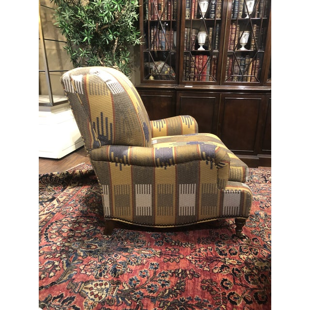 Comfortable chair with a wide seat. Can't beat the quality of Ralph Lauren. Brass nailhead trim.