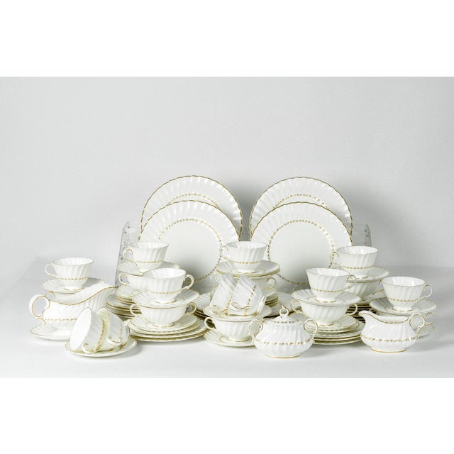 English Royal Doulton Fine Bone China Dinnerware Service For 12 people with serving pieces. This includes; soup coupes,...
