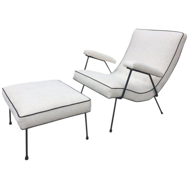 Great curves and scale on this comfortable Pearsall lounge chair. This has a chic look, furniture as art. Ivory chenille...