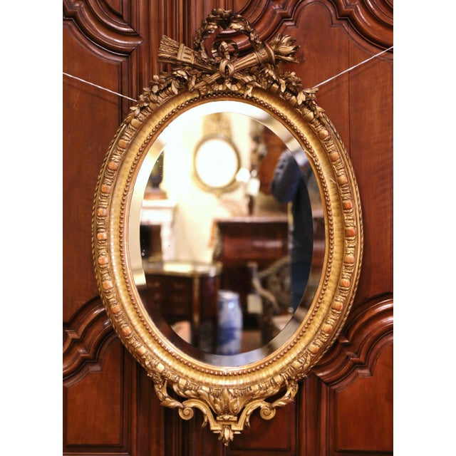 19th Century French Louis XVI Carved Giltwood Oval Wall Mirror With Torch Motif For Sale - Image 12 of 12