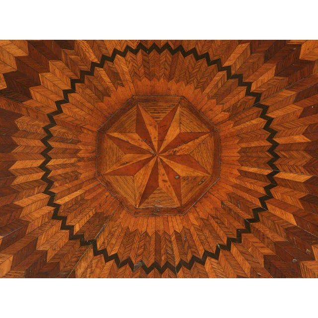 Circa 1880's real marquetry top table.It took over 1000 pieces of wood to create this kaleidoscope design. Ebony, cherry,...