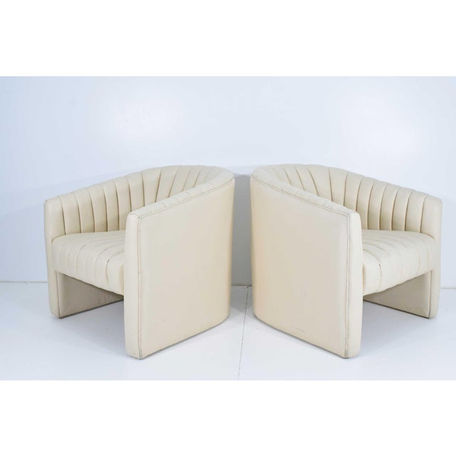 These chairs have great style. Channel tufting currently in a vinyl. Chairs would benefit with new upholstery and would...