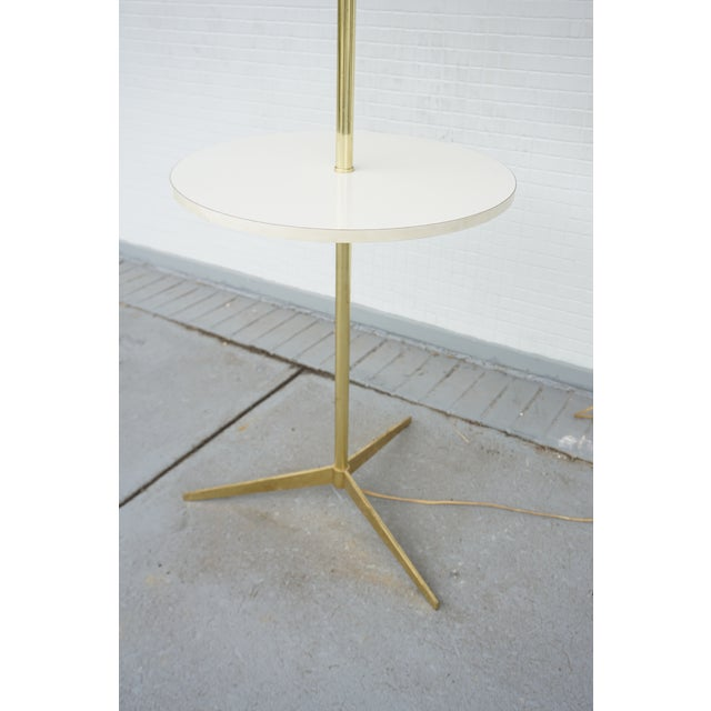 Awesome vintage mid century modern Paul McCobb style floor lamp table. This brass floor lamp with a built in white formica...