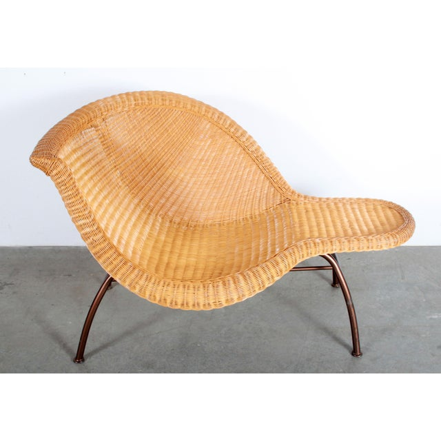 Stunning vintage mid century modern wicker chaise lounge on a bronze enameled steel frame! It is very reminescent of the...