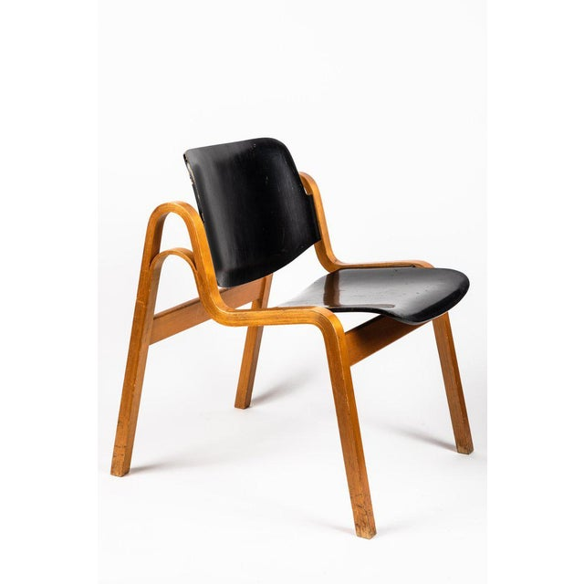 1950s Ilmari Tapiovaara Wilhelmina' chair. Executed in laminated birch and black lacquered laminated wood. Produced by...