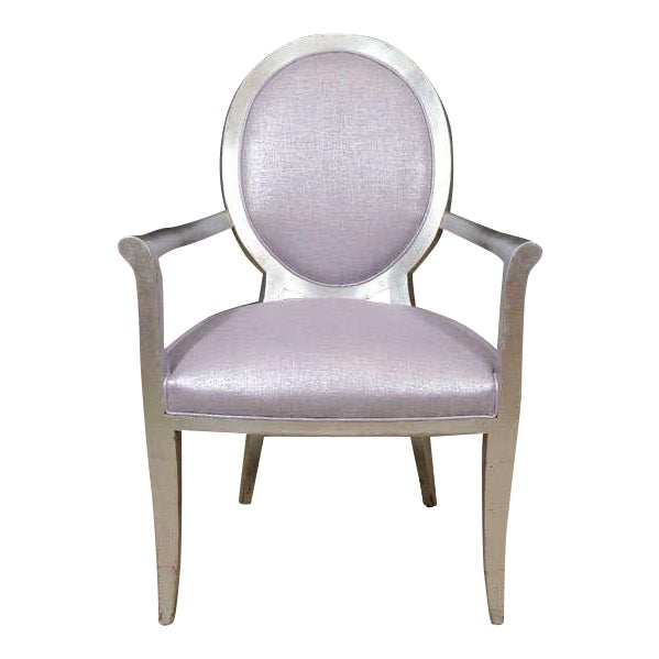 A glamorous pair of silvered wood Louis XVI style fauteuils covered in a fabulous glimmering violet glazed linen.