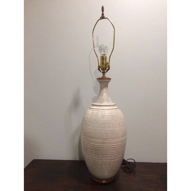A tall single hand thrown Danish pottery lamp. Elegant bottle form design with wheel turned throw lines and an eggshell...