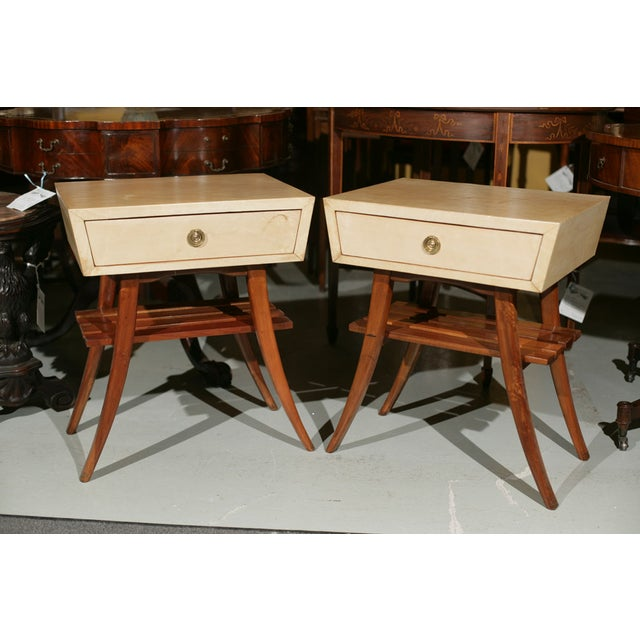 Pair of chic Art Deco stands, circa 1950s, parchment covered drawer on top of mahogany stands with one slatted tier.
