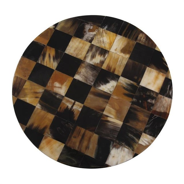 The Elias Round Tiled Horn Stool The Elias collection features inlaid brown and black colored horn from the Asiatic...