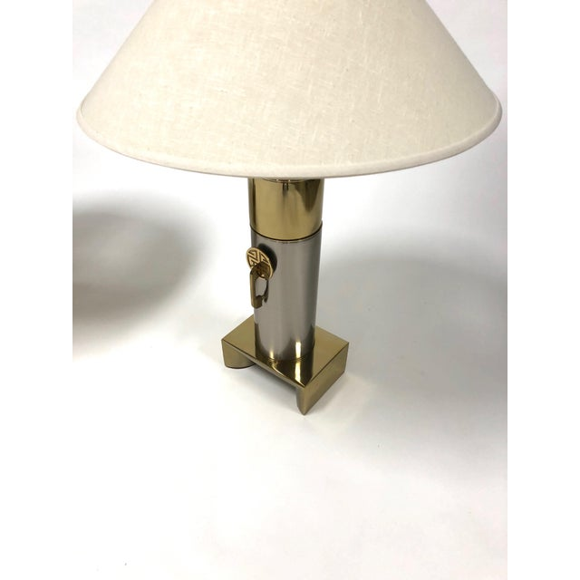 """Pair of brushed chrome and brass Asian inspired Laurel lamps circa 1970s The lamps are 34.75"""" high to top of finial, base..."""