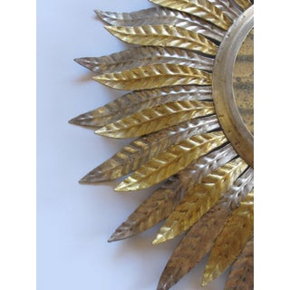 A Fanciful Set of 3 French Art Deco Silver and Gold Tole Sunburst Mirrors Preview