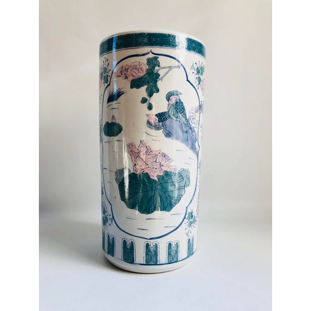 Vintage Chinese porcelain umbrella holder hand-decorated with large floral motif in blue, green, pink and lavender. No...