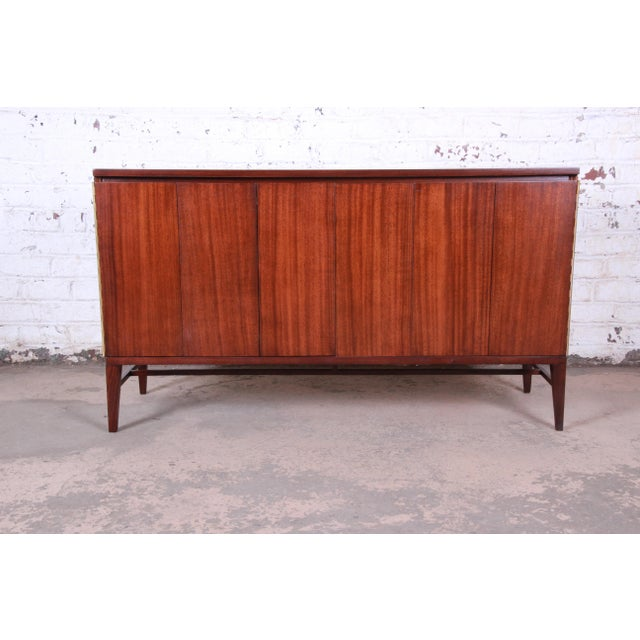 An exceptional mid-century modern sideboard credenza or bar cabinet designed by Paul McCobb for his Irwin Collection line...