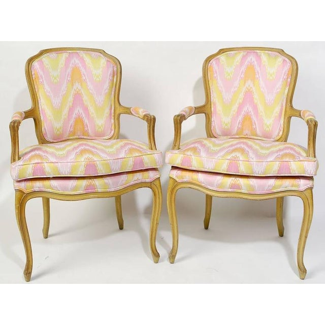 Pair of 1940s Louis XV style open armchairs with original antique glazed and distressed painted finish. Newly upholstered...