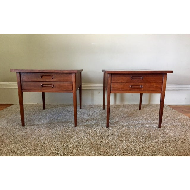 Beautiful pair of Founders side tables designed by Jack Cartwright. Danish design with a walnut finish. The tops of these...